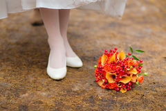 Bride's shoes and bouquet on the grass Royalty Free Stock Images
