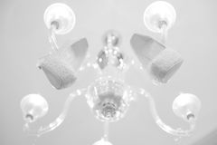 Bride's shoes on the chandelier Stock Image