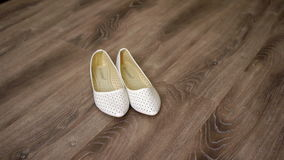 Bride's shoes on the floor stock footage