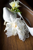 Bride's shoes and garter. On wooden table stock photo