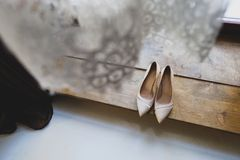 The bride`s shoes are in the hotel room. Wedding morning or day. Morning bride. In the foreground, Bridal veil royalty free stock photos
