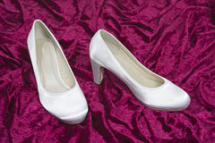 Bride's shoes on a red velvet Stock Photo
