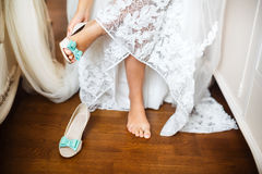 Bride's shoes on wedding day Stock Photos
