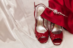 Bride's shoes, wedding gown and tiera. Bride's wedding shoes, tierra and gown, with the maid of honors gown Royalty Free Stock Image