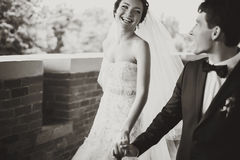 Bride's smile shines during her walk with a groom Royalty Free Stock Images