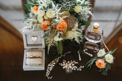 Bride`s wedding accessories, ring box, shoes, stock photo