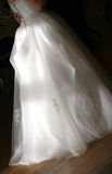 A Bride's Wedding Dress. Lit by the sun stock images