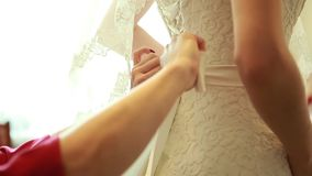The bride's wedding dress help to confusion stock video