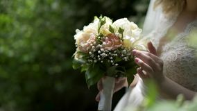 Bride`s wedding flowers. A bride`s bouquet is in the hands of the bride stock video footage