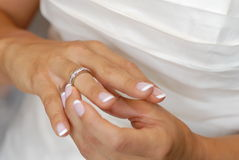 Bride's Wedding Ring. Closeup of bride's hands and wedding ring, in preparation for wedding Stock Photography