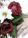 Bride's wedding ring hand and bouquet closeup stock photo