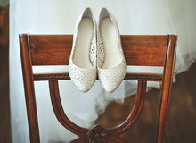 Bride's wedding shoes and dress Royalty Free Stock Photography