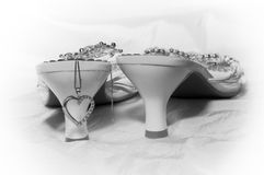 Bride's Wedding Shoes and her necklace. Bride's Wedding shoes laced with her heart pendent necklace Stock Images