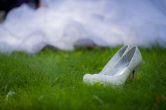 Bride s White Shoes on a Grass Floor Stock Images