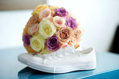 Bride`s white sneackers and beautiful bridal bouquet Royalty Free Stock Image