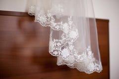 Bride's white wedding veil close-up. Detail of wedding, bride's white veil close-up Royalty Free Stock Photo