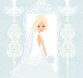 Bride at the salon in wedding dress Royalty Free Stock Image