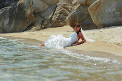 Bride on a sandy beach Stock Photos