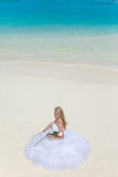 The bride on a sandy beach Royalty Free Stock Images