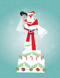 Bride with Santa. Groom dressed as Santa lifting bride while standing on a cake Stock Photography