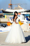 Bride in a Santorini harbor in GREECE. A shot with a brunette bride on a small port in Santorini Royalty Free Stock Photography