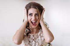 The bride screams
