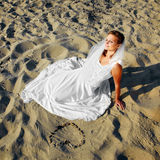Bride on sea shore Stock Photos