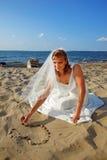Bride on sea shore Stock Image