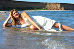 Bride of the sea - trash the wedding dress royalty free stock image