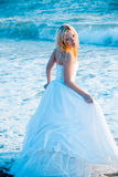 Bride in sea water Royalty Free Stock Photography