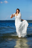 Bride in sea waves Royalty Free Stock Photography