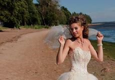 The bride on seacost Royalty Free Stock Image