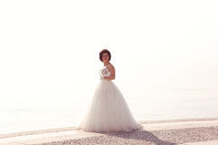 Bride at seashore Royalty Free Stock Image