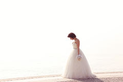 Bride at seashore Royalty Free Stock Images