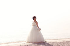 Bride at seashore Royalty Free Stock Photo
