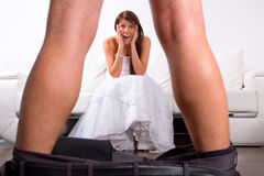 Bride shocked at the groom striptease. At home Royalty Free Stock Photo