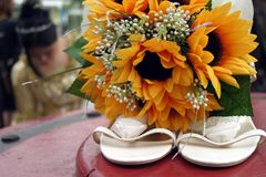 Bride with shoes and flowers Stock Photos