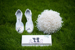 Bride shoes in green grass stock photography