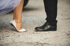 Bride Shoes and Groom's Unstuck Shoes Royalty Free Stock Photography