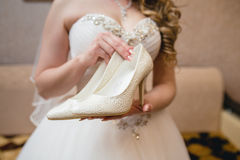 Bride shoes in hands Stock Image