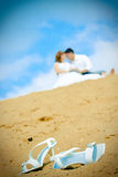 bride shoes and newly married couple Stock Photo