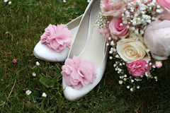 Bride shoes. And roses and gypsophila bouquet Royalty Free Stock Image