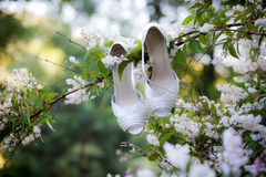 Bride shoes on rustic car Royalty Free Stock Photos