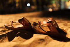 Bride shoes on sand night time Stock Images