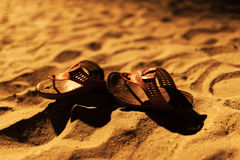 Bride shoes on sand night time Stock Photography
