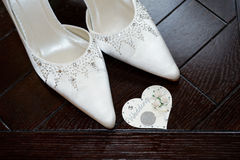 Bride shoes and six pence Royalty Free Stock Photo