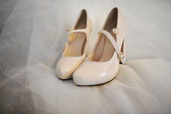 Bride shoes on a veil Stock Photos