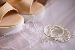 Bride shoes and wedding accessories on background of a veil Royalty Free Stock Photo