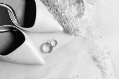 Bride shoes and wedding rings Stock Image