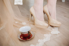 Bride shoes white wedding veil on the floor with lace, Cup Royalty Free Stock Images